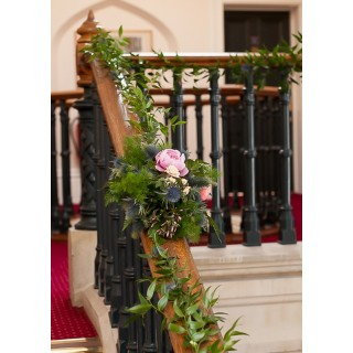 Ruscus Garlands & Flower Clusters adorn Oakwood Houses Staircase